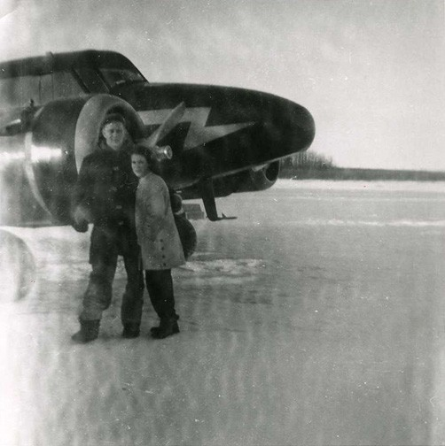Merlyn and Jean with Anson aircraft on the Hay River ice. Photo taken at the West Channel. Winter 1955 / 56